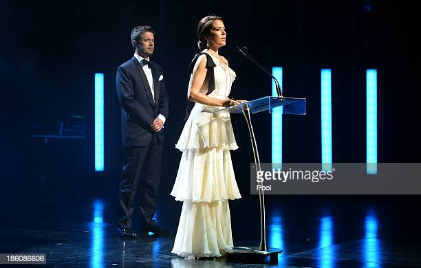 Princess Mary of Denmark speaks at the Sydney Opera House as Prince Frederik of Denmark looks on as they attend the Crown Prince Couple Awards 2013...