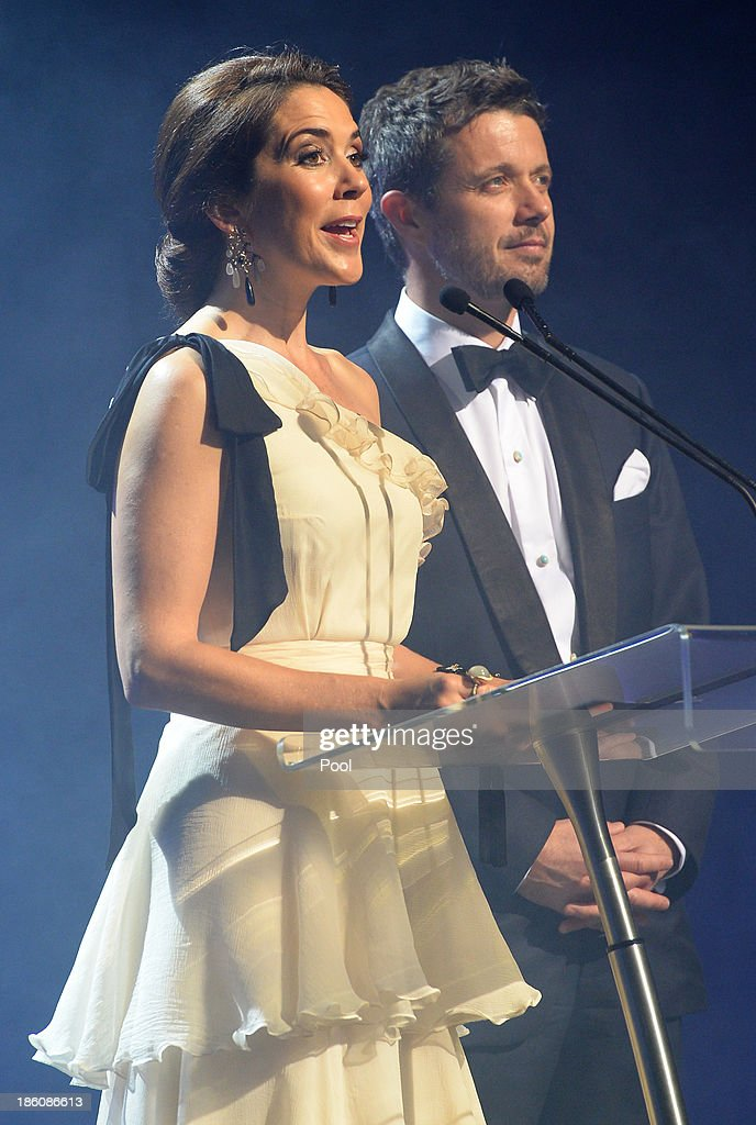 Princess Mary of Denmark speaks at the Sydney Opera House as Prince Frederik of Denmark looks on as they attend the Crown Prince Couple Awards 2013 at Sydney Opera House on October 28, 2013 in Sydney, Australia. Prince Frederik and Princess Mary are on a five day visit to Sydney and will attend events to celebrate the 40th anniversary of the Sydney Opera House and the Danish architect who designed the landmark, Jorn Utzen.