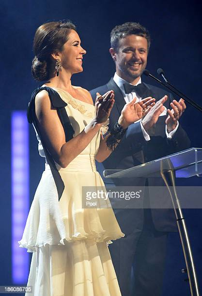 Princess Mary of Denmark speaks onstage as Prince Frederik of Denmark looks on as they attend the Crown Prince Couple Awards 2013 at Sydney Opera...