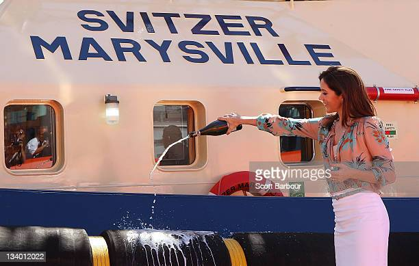 Princess Mary of Denmark sprays champagne as she christens the tugboat 'Svitzer Marysville' during the naming ceremony on November 24 2011 in...