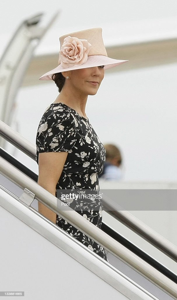 Princess Mary of Denmark walks down a staircase as she arrives at Fairbairn Defence Establishment on November 22, 2011 in Canberra, Australia. Princess Mary and Prince Frederik are on their first official visit to Australia since 2008. The Royal visit begins in Sydney, before heading to Melbourne, Canberra and Broken Hill.