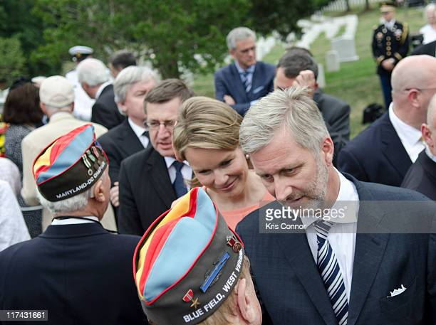 H Princess Mathilde and HRH Prince Philippe shake hans with veterans after laying a wreath at the Battle of the Bulge Memorial to honor those who...