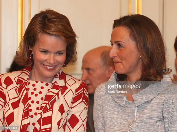 Princess Mathilde and Princess Claire of Belgium prepare for a group photo during the Queen Elisabeth International Music Competition of Belgium at...