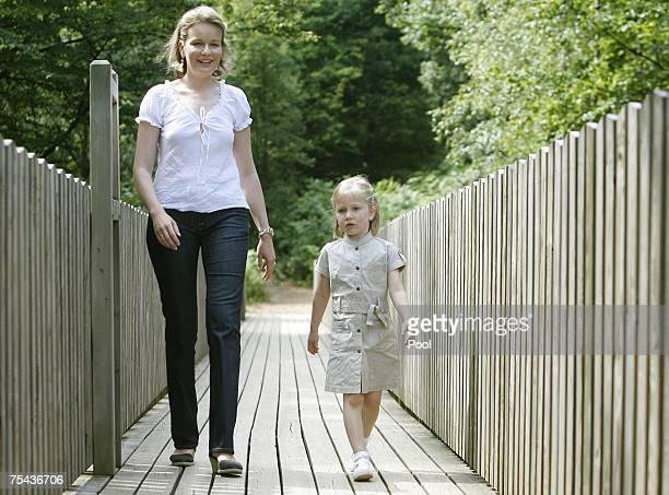 Princess Mathilde and Princess Elisabeth of Belgium walk in park Chlrophylle on July 16 in Dochamps Belgium