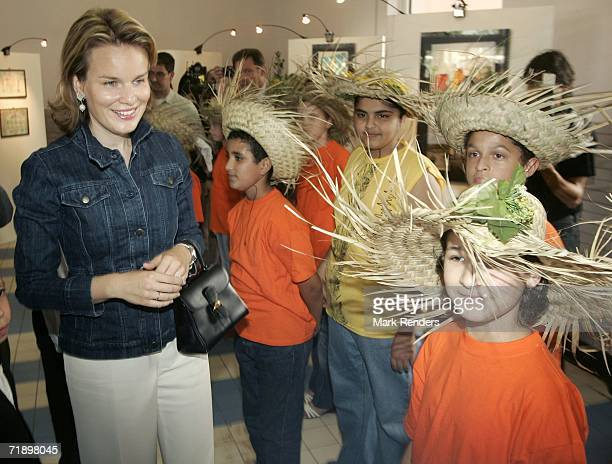 Princess Mathilde Duchess of Brabant of Belgium meets with students as she views an art exhibit done by immigrant children during her visit to the...
