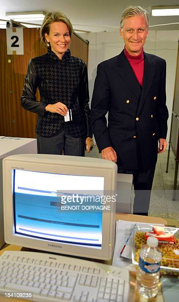 Princess Mathilde of Belgium and Crown Prince Philippe of Belgium cast their electronic ballot at a polling station during the Belgian municipal and...
