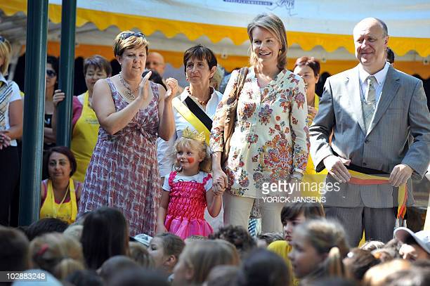 Princess Mathilde of Belgium and mayor of Maasmechelen Georges Lenssen are seen during a visit to the the playground organization 'De Saenhoeve' in...