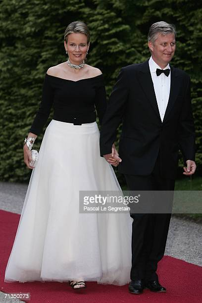Princess Mathilde of Belgium and Prince Philippe of Belgium pose as they arrive to attend a royal dinner that is part of the Grand Duke Henri of...