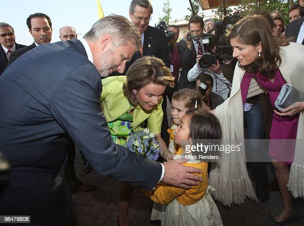 Princess Mathilde of Belgium and Prince Philippe of Belgium receive a birthday cake for Prince Philippe's 50th birthday as they are welcomed at Ghent...