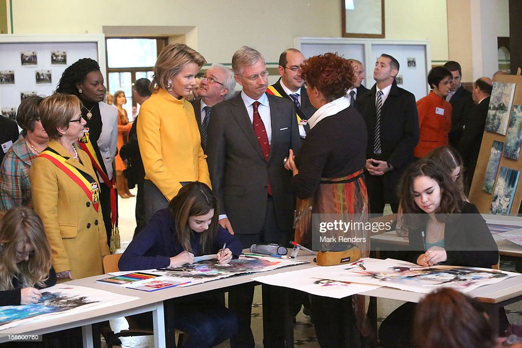 Princess Mathilde of Belgium and Prince Philippe of Belgium visit the CEPES School on December 20, 2012 in Jodoigne, Belgium.