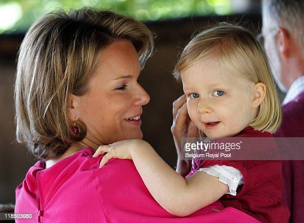 Princess Mathilde of Belgium and Princess Eleonore of Belgium photographed at the educational centre 'Archeosite' on July 8 2011 in Aubechies Belgium