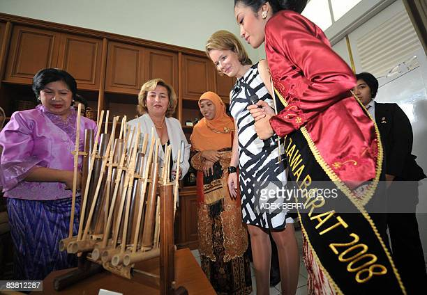 Princess Mathilde of Belgium looks at a traditional music instrument Angklung of west Java during a visit in Bandung on November 25 2008 Prince...