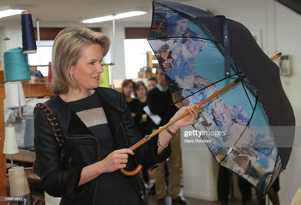Princess Mathilde of Belgium opens an umbrella during a visit at the ENSAV Arts Academy on November 26, 2012 in Brussels, Belgium.