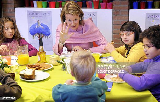 Princess Mathilde of Belgium reads a story for children of the nursery and primary school 'Kakelbont' in Brussels during the Reading breakfast of the...