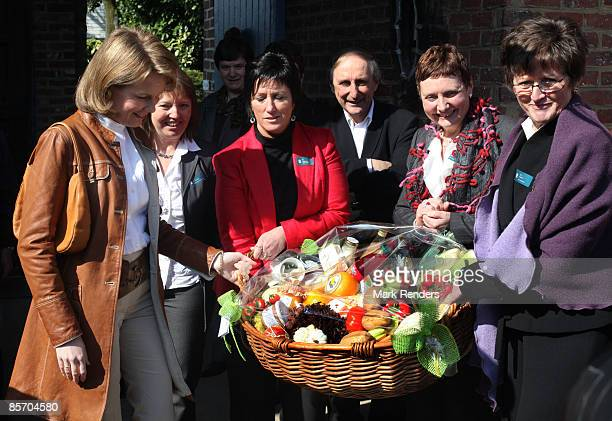 Princess Mathilde of Belgium receives a food hamper as a gift during her visit to 't Goteringenhof' farm on March 30 2009 in Gooik Belgium