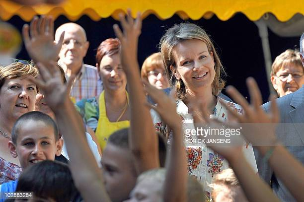 Princess Mathilde of Belgium smiles during a visit to the playground organization 'De Saenhoeve' in Maasmechelen on July 14 2010 AFP...