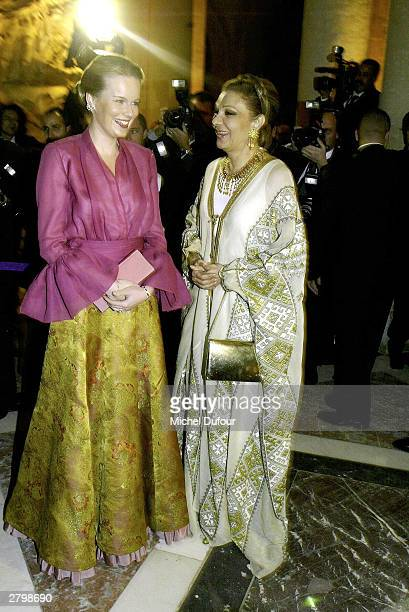 Princess Mathilde of Belgium talks with Empress Farah Diba of Iran at the Versailles Charity Gala on December 8 2003 in Versailles