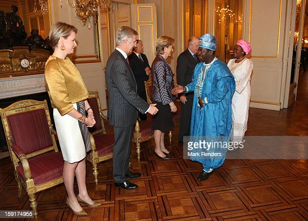 Princess Mathilde Prince Philippe Queen Paola and King Albert II of Belgium meet Ambassador of Benin Republic Charles Borromee Todjinou at Palais de...