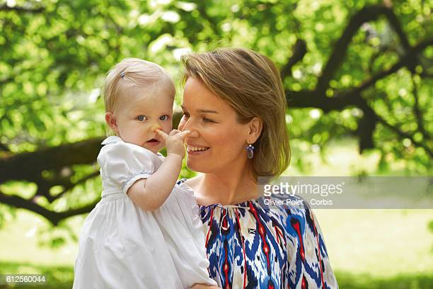 Princess Mathilde shares a moment with Princess Eleonore in the garden of the royal castle of Laeken