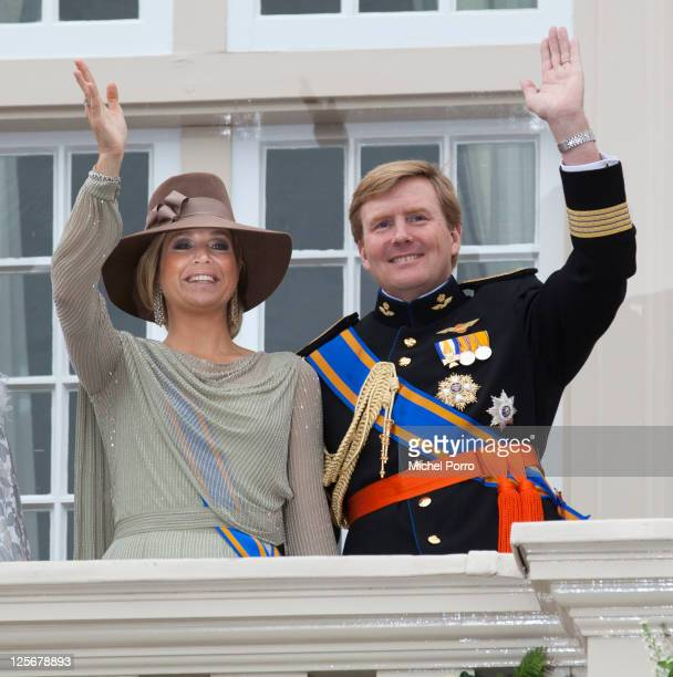 Princess Maxima and Crown Prince Willem Alexander of The Netherlands stand on the balcony of the Noordeinde Palace after the Queen's Budget...