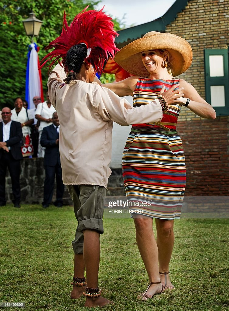 Princess Maxima dances with a man during : News Photo