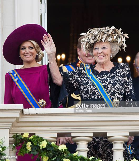 Princess Maxima of the Netherlands and Queen Beatrix of The Netherlands wave from the Noordeinde Palace balcony after attending Budget Day...