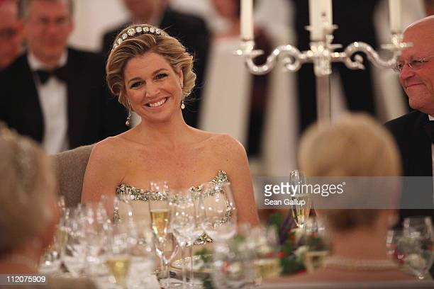 Princess Maxima of the Netherlands looks over at German First Lady Bettina Wulff as they attend a state banquet given in honour of the visiting Dutch...