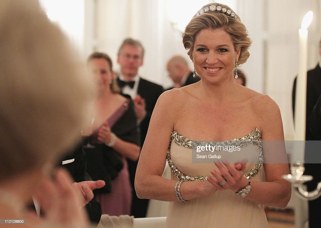Princess Maxima of the Netherlands looks to her mother-in-law, Queen Beatrix, while attending a state banquet given in honour of the visiting Dutch royals at Bellevue Presidential Palace on April 12, 2011 in Berlin, Germany. The Dutch royals, including Queen Beatrix, Prince Willem-Alexander and Princess Maxima, are on a four-day visit to Germany that includes stops in Berlin, Dresden and Duesseldorf.