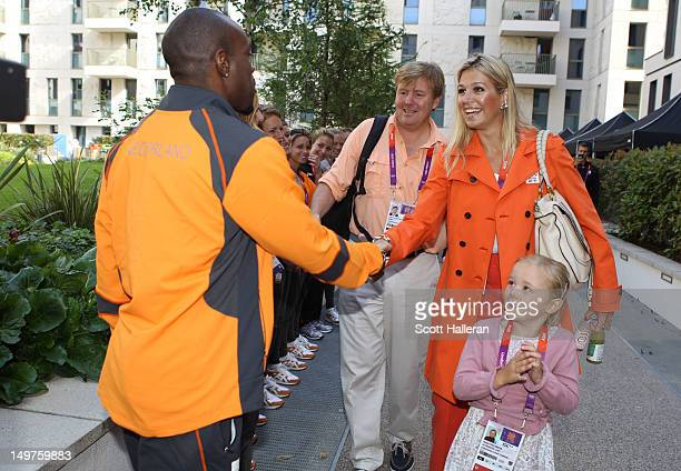 Princess Maxima of the Netherlands shakes hands with sprinter Churandy Martina during a tour of the Olympic Village on Day 7 of the London 2012...