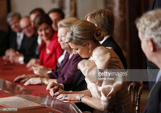 Princess Maxima of the Netherlands smiles as she signs the Act of Abdication for Queen Beatrix of the Netherlands in the Moseszaal at the Royal...