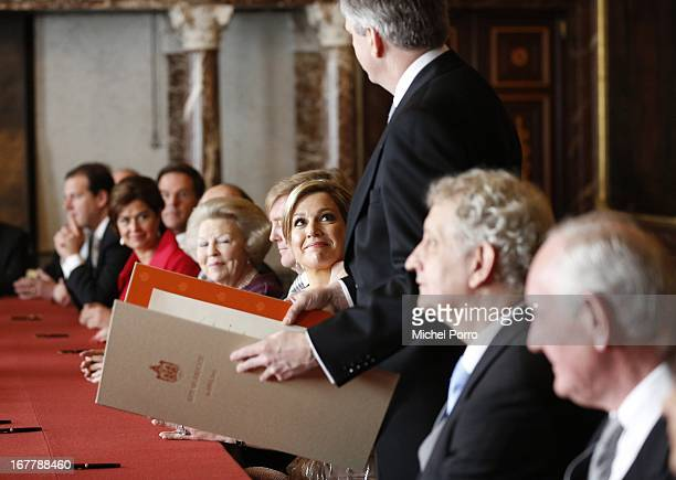 Princess Maxima of the Netherlands smiles during the ceremony for the Act of Abdication by Queen Beatrix of the Netherlands in the Moseszaal at the...