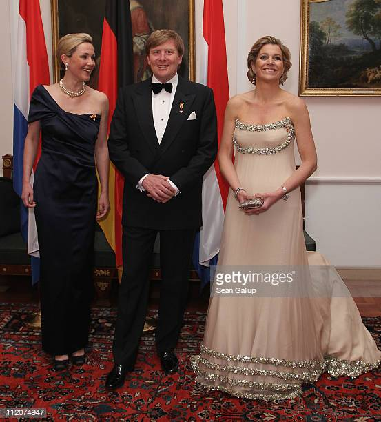 Princess Maxima Prince WillemAlexander of the Netherlands and German First Lady Bettina Wulff attend a state banquet given in honour of the visiting...