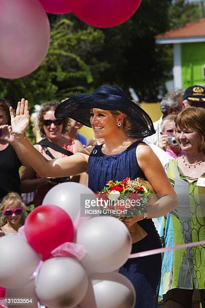 Princess Maxima waves on October 31, 2011 during the opening of a building of the Youth and Family Foundation in Kraiendijk on the Dutch Caribean...