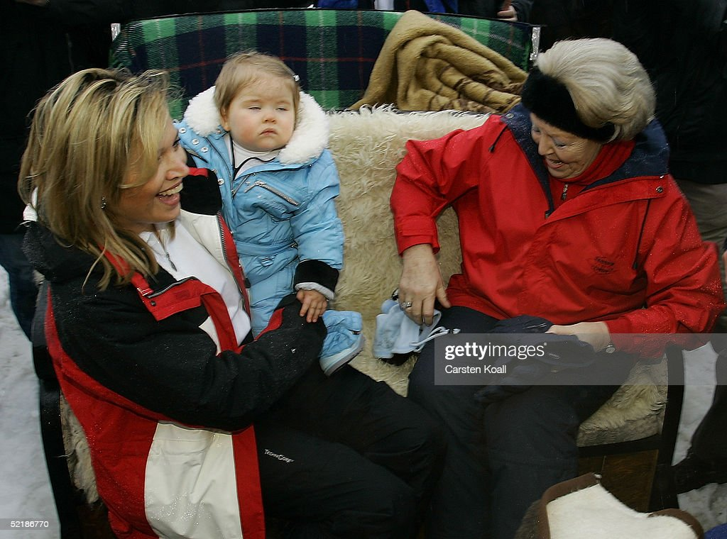 Princess Maxima (L), with her daughter Princess Almalia and Queen Beatrix (R) of the Dutch Royal Family pose at a photocall during their winter holiday at Lech on June 5, 2005 in Lech, Austria.