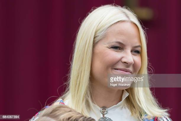 Princess Mette Marit of Norway greets the children in the parade at their home Skaugum on Norway's National Day on May 17 2017 in Asker Norway