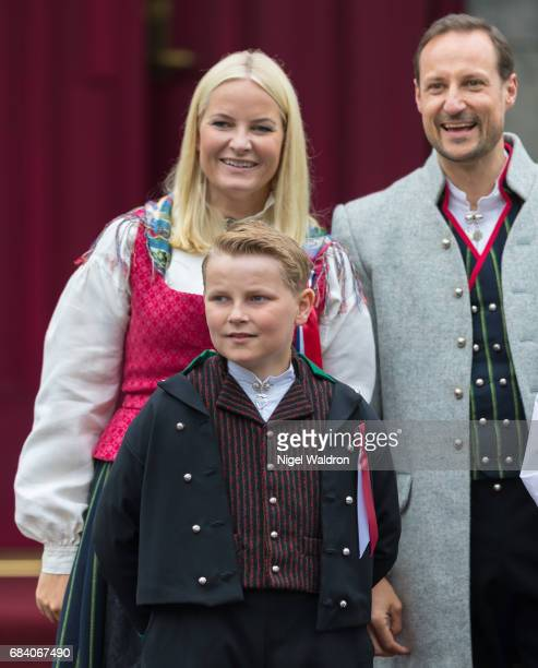 Princess Mette Marit of Norway Prince Haakon of Norway Prince Sverre Magnus of Norway greet the children in the parade at their home Skaugum on...