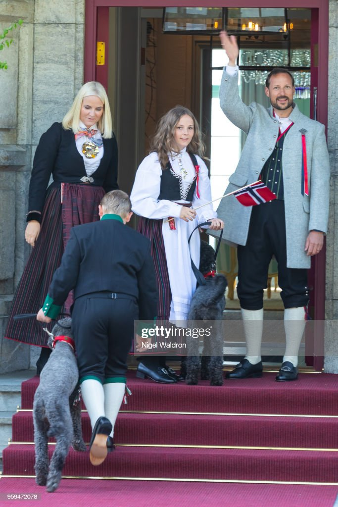 Princess Mette Marit of Norway, Prince Sverre Magnus of Norway, Princess Ingrid Alexandra of Norway, Prince Haakon Magnus of Norway, Muffins Krakebolle and Milly Kakao bidding the childrens parade farewell and going into their house of residence at Skaugum, Asker on Norway's National Day on May 17, 2018 in Oslo, Norway.