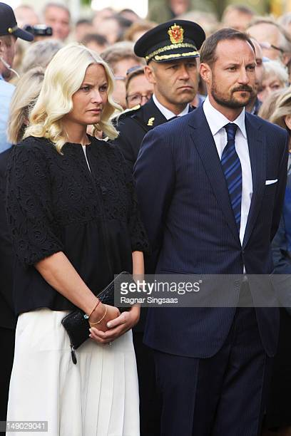 Princess MetteMarit of Norway and Prince Haakon of Norway attend a wreath laying ceremony at the Ministries to commemorate the anniversary of the...