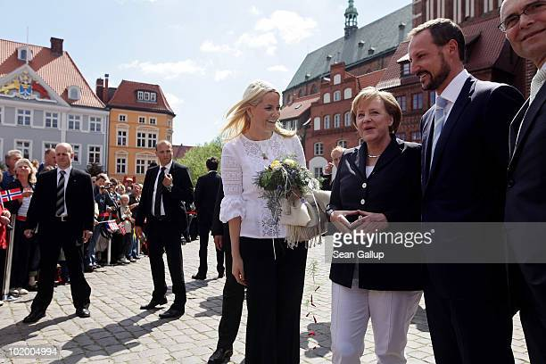 Princess Mette-Marit of Norway , Prince Haakon of Norway and German Chancellor Angela Merkel stand on the main square on June 12, 2010 in Stralsund,...