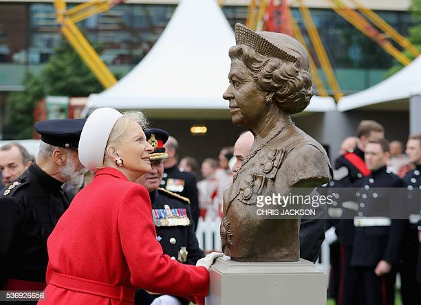 Princess Michael of Kent examines a bronze bust of Queen Elizabeth II during a visit to the Honourable Artillery Company in London on June 1 2016 The...