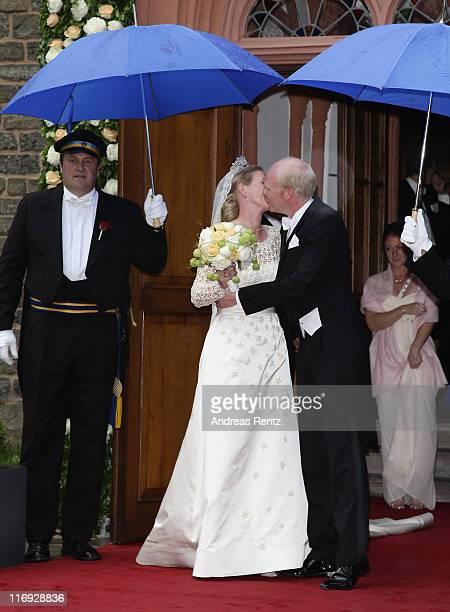 Princess Nathalie zu SaynWittgensteinBerleburg and Alexander Johannsmann kiss each other after getting married the evangelic Stadtkirche on June 18...