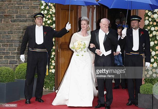Princess Nathalie zu SaynWittgensteinBerleburg and Alexander Johannsmann leave after getting married the evangelic Stadtkirche on June 18 2011 in Bad...