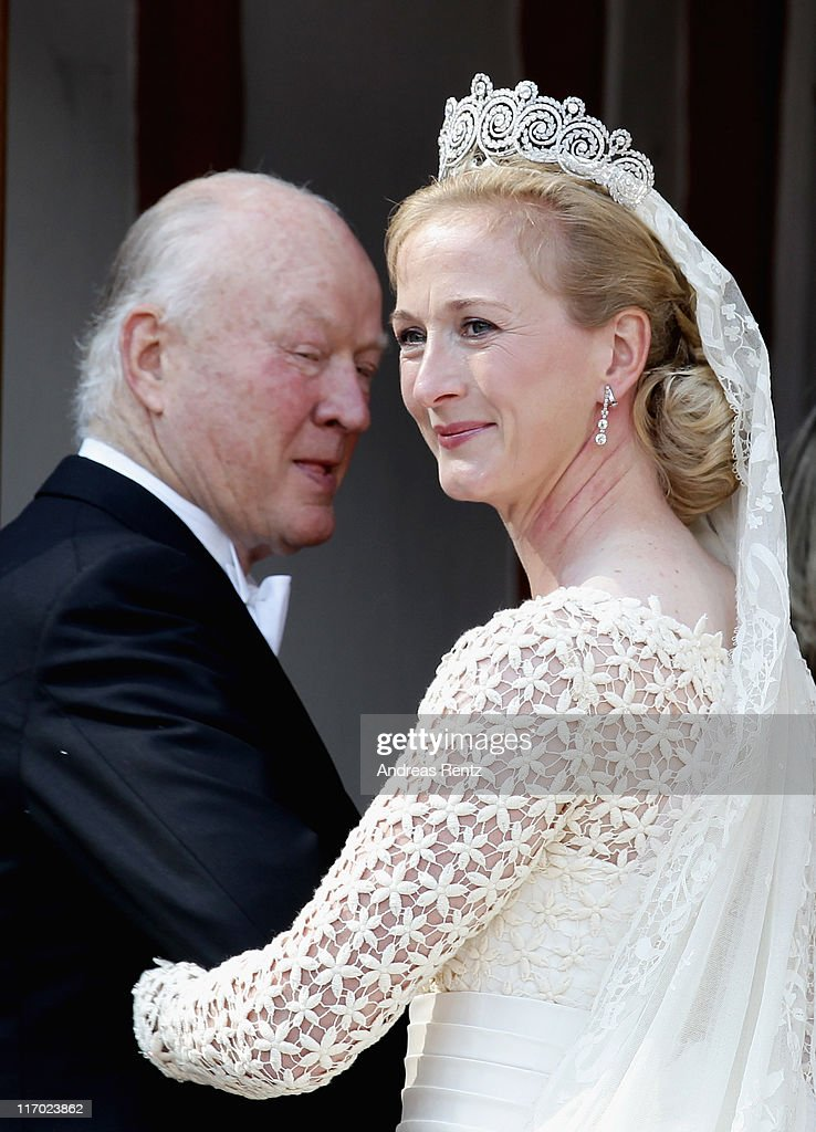 Princess Nathalie zu Sayn-Wittgenstein-Berleburg and her father Richard Prince zu Sayn-Wittgenstein-Berleburg arrive to her wedding to Alexander Johannsmann at the evangelic Stadtkirche on June 18, 2011 in Bad Berleburg, Germany.