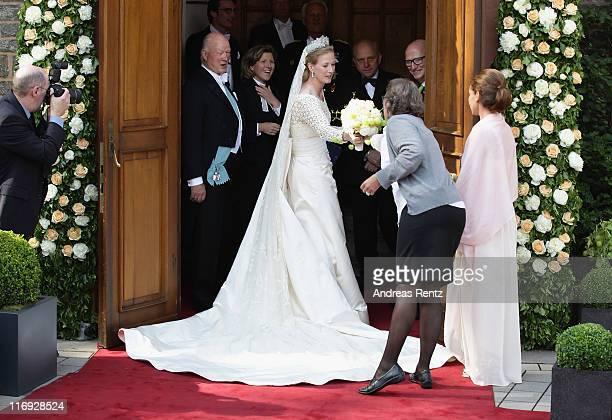 Princess Nathalie zu SaynWittgensteinBerleburg receives her bridal bouquet prior to her wedding to Alexander Johannsmann at the evangelic Stadtkirche...