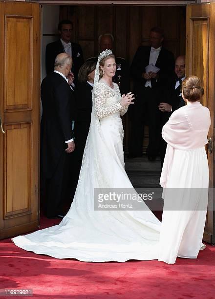 Princess Nathalie zu SaynWittgensteinBerleburg waits for her bridal bouquet prior to her wedding to Alexander Johannsmann at the evangelic...