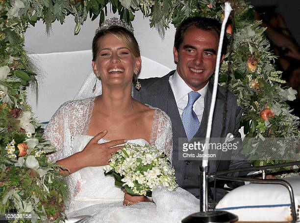 Princess Nikolaos of Greece and Denmark leave in a horse drawn carriage after getting married at the Cathedral of Ayios Nikolaos on August 25 2010 in...