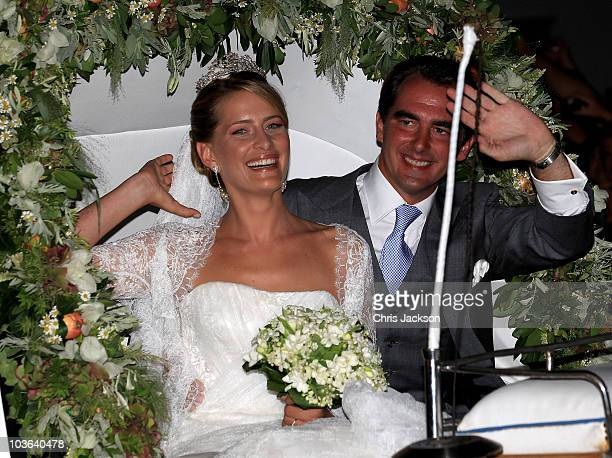 Princess Nikolaos of Greece and Denmark leave in a horse drawn carriage after getting married at the Cathedral of Ayios Nikolaos on August 25, 2010...