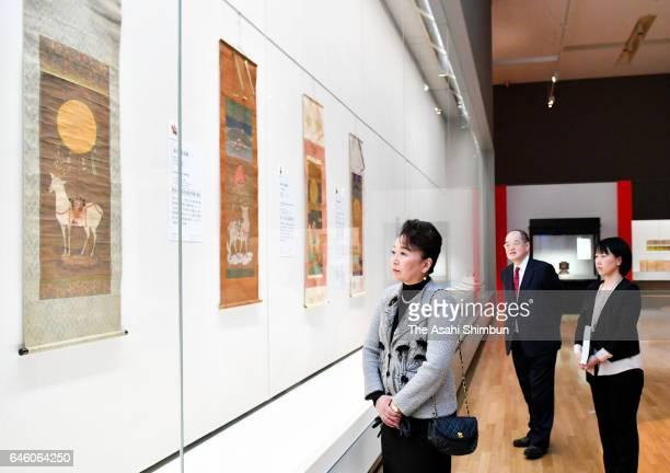 Princess Nobuko of Mikasa watches exhibits as she visits the 'Eternal Treasures from Kasugataisha Shrine' at the Tokyo National Museum on February...