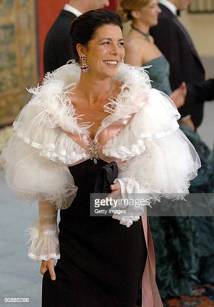 Princess of Hanover Caroline smiles as she arrives to attend a gala dinner at El Pardo Royal Palace May 21, 2004 in Madrid. Spanish Crown Prince...