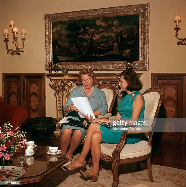Princess of Iran Soraya the second wife and Queen Consort of the late Shah of Iran is seated next to her mother Eva Karl in the elegant livingroom of...